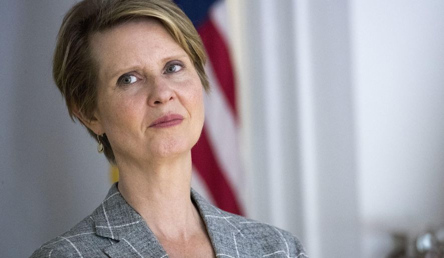 """FILE - In this June 13, 2018 file photo, Democratic candidate for governor Cynthia Nixon attends a campaign event at Borough of Manhattan Community College in New York. Up against an entrenched incumbent with a $30 million war chest, the former """"Sex and the City"""" star and liberal activist is taking inspiration from Alexandria Ocasio-Cortez's long-shot victory in Tuesday's Democratic congressional primary. Nixon faces two-term Gov. Andrew Cuomo in New York's September Democratic primary. (AP Photo/Mary Altaffer, File)"""