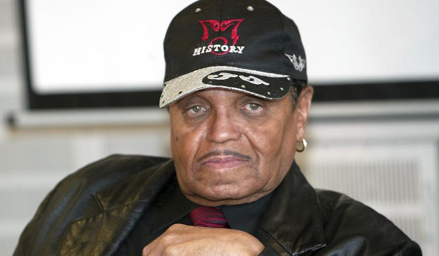 In this March 4, 2005, file photo, music producer Joseph Jackson, father of popstar Michael Jackson, appears at a news conference in Lindlar near Cologne, western Germany. Jackson, the fearsome stage dad of Michael Jackson, Janet Jackson and their talented siblings, who took his family from poverty and launched a musical dynasty, died Wednesday, June 27, 2018. He was 89.(AP Photo Hermann J. Knippertz, File)