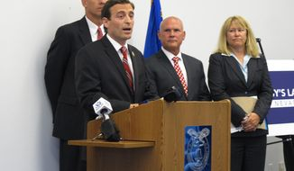 """FILE - In this June 10, 2015 file photo, Nevada Attorney Gen. Adam Laxalt addresses reporters at a news conference at the Mills B. Lane Justice Center in Reno, Nev. Laxalt says schools could be made safer by stepping up protections at school properties, encouraging students to report troubled classmates and asking the Legislature to look at so-called """"red flag"""" laws to allow guns to be confiscated from people deemed to be a threat. (AP Photo/Scott Sonner, File)"""