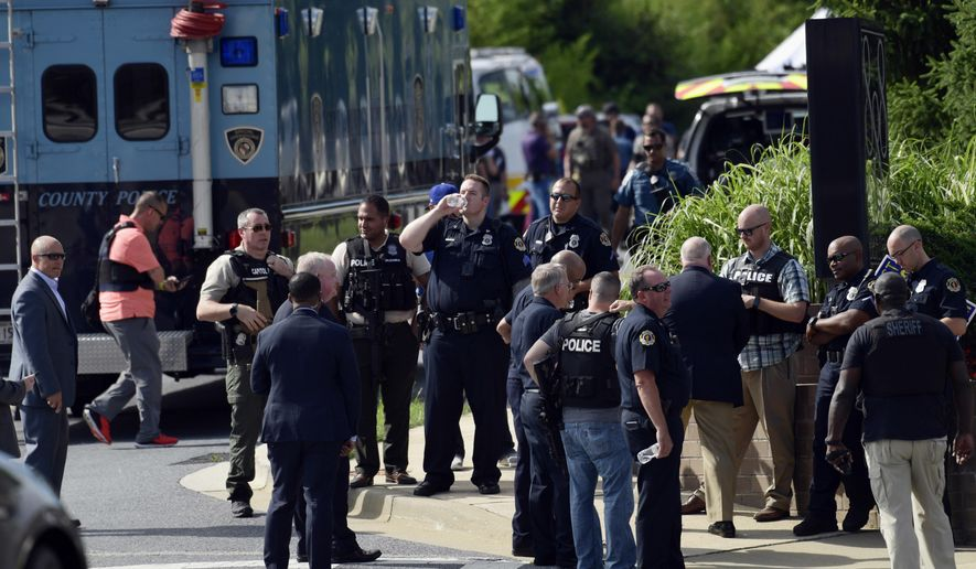 Police secure the scene of a shooting in Annapolis, Md., Thursday, June 28, 2018. A single shooter killed several people Thursday and wounded others at a newspaper in Annapolis, Maryland, and police said a suspect was in custody. (AP Photo/Susan Walsh)