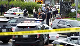 Authorities stage at the office building entrance after multiple people were shot at The Capital Gazette newspaper in Annapolis, Md., Thursday, June 28, 2018. (AP Photo/Jose Luis Magana)