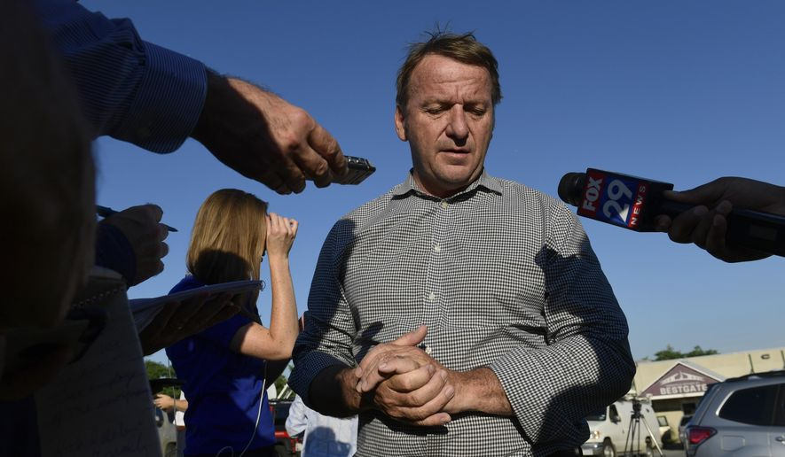 Annapolis Mayor Gavin Buckley speaks with reporters near the scene of a shooting in Annapolis, Md., Thursday, June 28, 2018. A gunman opened fire at a newspaper office in Annapolis on Thursday, killing several people and wounding several others before being taken into custody. (AP Photo/Susan Walsh)