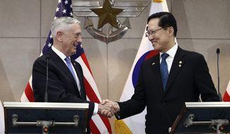 U.S. Defense Secretary Jim Mattis, left, shakes hands with South Korean Defense Minister Song Young-moo before their meeting in Seoul, South Korea Thursday, June 28, 2018.  (Chung Sung-jun/Pool Photo via AP)