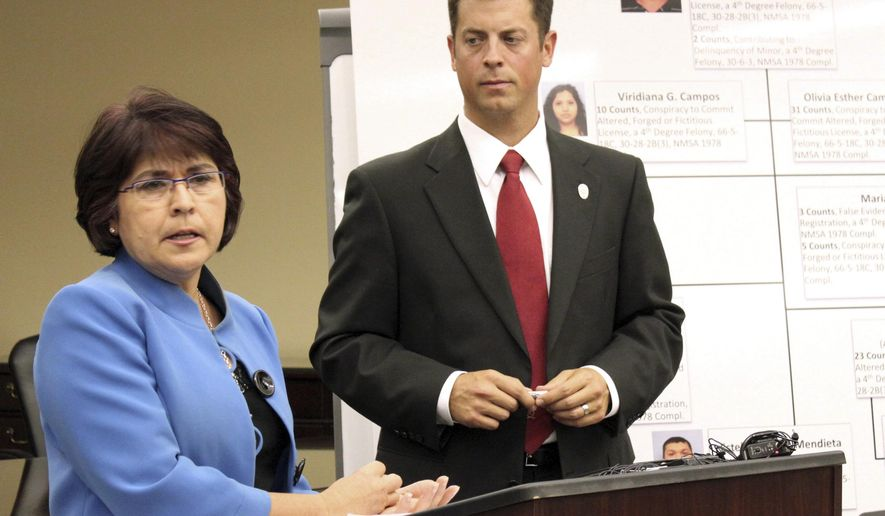 FILE - In this June 6, 2012 file photo, New Mexico Taxation and Revenue Department Secretary Demesia Padilla, left, answers questions as Ninth Judicial District Attorney Matt Chandler listens during a news conference in Albuquerque, N.M., on Wednesday June 6, 2012. Padilla on Thursday, June 28, 2018 was charged with embezzlement, and multiple corruption and ethics violations stemming from her time as Cabinet secretary. (AP Photo/Susan Montoya Bryan, File)