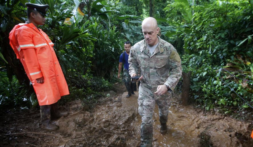 U.S. Special Operations Command Pacific Search and Rescue team personne; walk out of a cave where young soccer team and their coach are believed to be missing, Thursday, June 28, 2018, in Mae Sai, Chiang Rai province, in northern Thailand. A U.S. military team and British cave experts joined the rescue effort for 12 boys and their soccer coach missing for five days inside the cave being flooded by near-constant rains. (AP Photo/Sakchai Lalit)