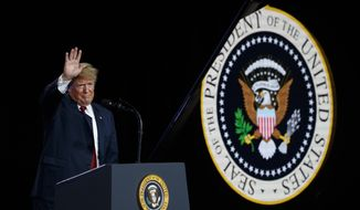 President Donald Trump waves after delivering remarks at a Foxconn facility, Thursday, June 28, 2018, in Mt. Pleasant, Wis. (AP Photo/Evan Vucci)