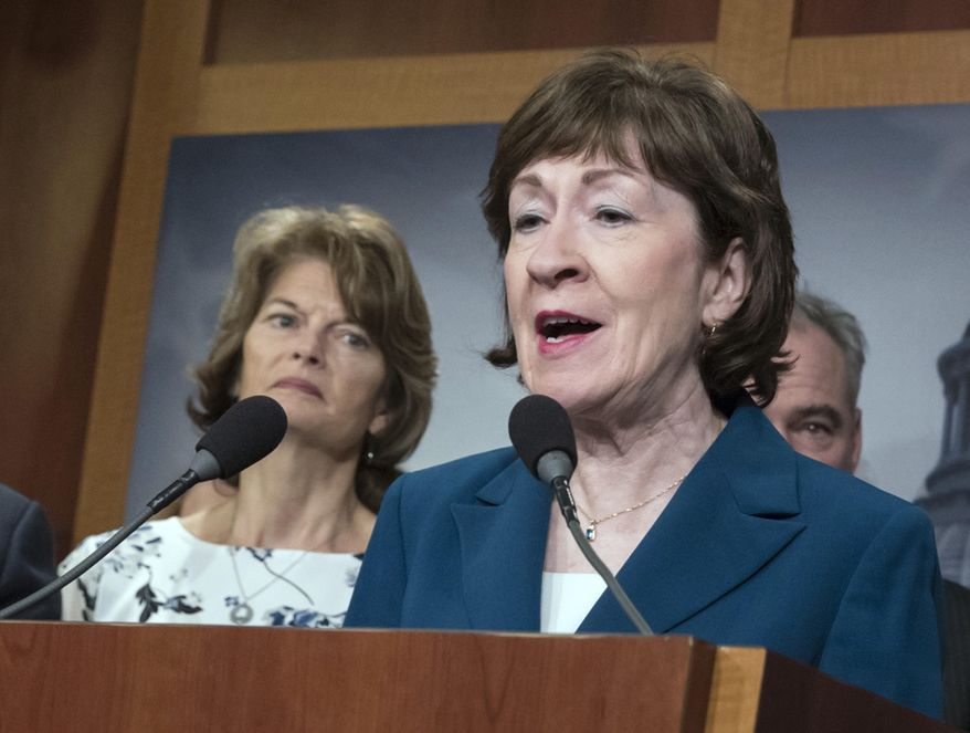 Sen. Susan Collins, R-Maine and Sen. Lisa Murkowski, R-Alaska, left, are shown during a news conference at the Capitol in Washington on Feb. 15, 2018. (Associated Press) **FILE**