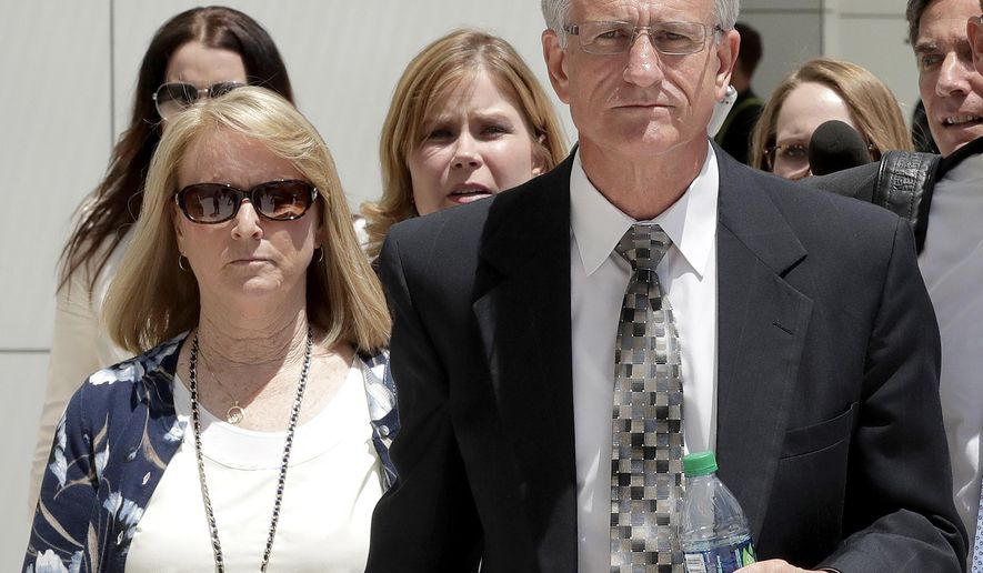 FILE - In this June 7, 2017 file photo, former Arizona Corporation Commissioner Gary Pierce, right, and his wife Sherry leave court in Phoenix after being arraigned on bribery and fraud charges. Attorneys made closing arguments Thursday, June 28, 2018 at the couple's trial. Authorities say a water company owner funneled $31,000 to Pierce and Pierce's wife through a consulting firm in exchange for favorable decisions from Gary Pierce. The couple has pleaded not guilty to the charges. (AP Photo/Matt York, File)