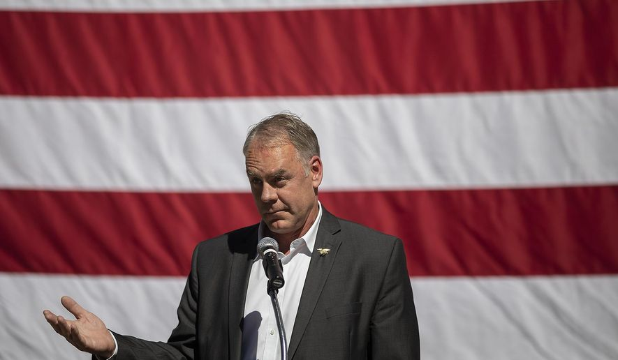 U.S. Interior Secretary Ryan Zinke gestures after a woman interrupted his speech by shouting questions in the auditorium at Mount Rushmore National Memorial in Keystone, S.D. during the Western Governors Association annual meeting Tuesday, June 26, 2018. (Ryan Hermens/Rapid City Journal via AP)