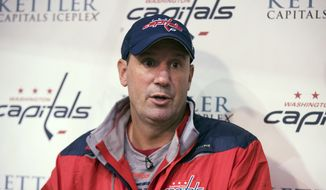 FILE - In this Sept. 23, 2016, file photo, Washington Capitals assistant coach Todd Reirden speaks to reporters during the first day of NHL hockey training camp in Arlington, Va. The Stanley Cup-champion Capitals have promoted Reirden to head coach to replace Barry Trotz. General manager Brian MacLellan announced the anticipated move on Friday, June 29, 2018.  (AP Photo/Manuel Balce Ceneta, File)