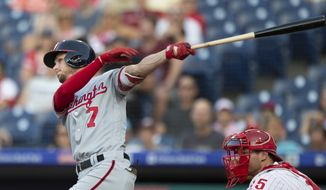 Washington Nationals' Trea Turner follows through on a two-run home run in the first inning of the team's baseball game against the Philadelphia Phillies, Friday, June 29, 2018, in Philadelphia. (AP Photo/Laurence Kesterson)
