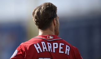 Washington Nationals' Bryce Harper looks on during a baseball game against the Philadelphia Phillies, Saturday, June 23, 2018, in Washington. (AP Photo/Nick Wass)