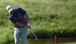 Marc Leishman, of Australia, hits onto the 14th green during the second round of the Quicken Loans National golf tournament, Friday, June 29, 2018, in Potomac, Md. (AP Photo/Nick Wass)