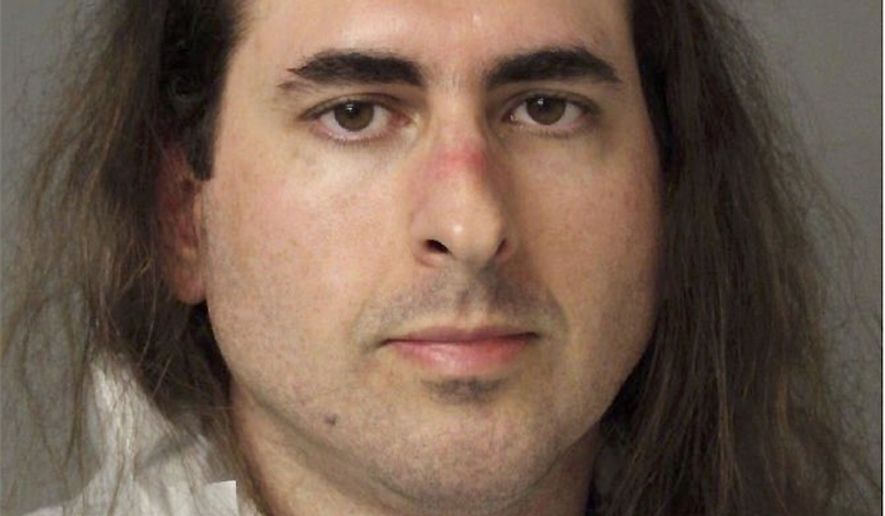 In this June 28 2018, photo released by the Anne Arundel Police, Jarrod Warren Ramos poses for a photo, in Annapolis, Md. First-degree murder charges were filed Friday against Ramos who police said targeted Maryland's capital newspaper, shooting his way into the newsroom and killing four journalists and a staffer before officers swiftly arrested him. (Anne Arundel Police via AP)