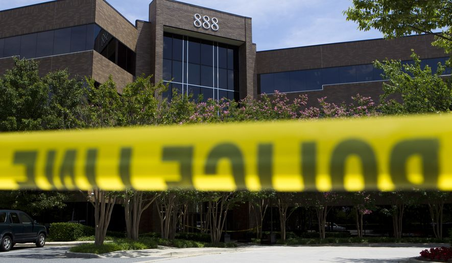 Police tape surrounds the front entrance of the office building housing The Capital Gazette newspaper in Annapolis, Md., on Friday, June 29, 2018. A man armed with smoke grenades and a shotgun attacked journalists in the building Thursday, killing several people before police quickly stormed the building and arrested him, police and witnesses said. (AP Photo/Jose Luis Magana)