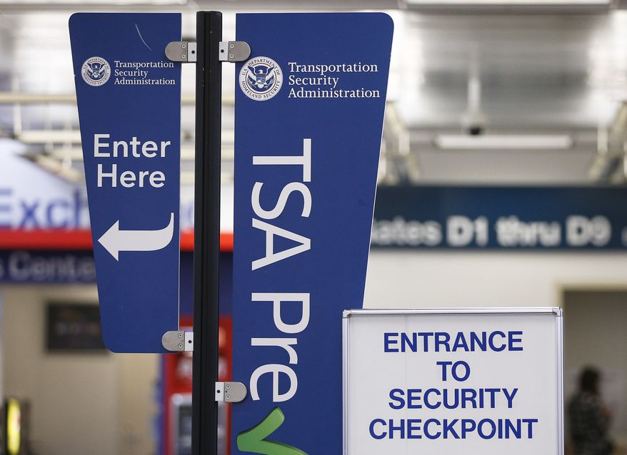 A TSA pre-check sign at a security checkpoint is on display for travelers to easily see at the Fort Lauderdale Hollywood International Airport on Friday, June 29, 2018, in Fort Lauderdale, Fla. (AP Photo/Brynn Anderson)