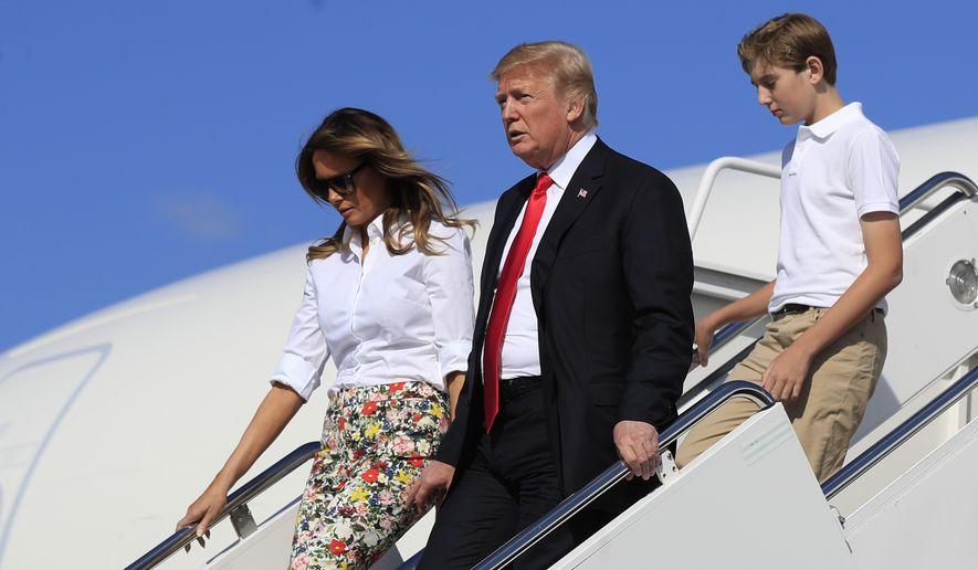 President Donald Trump, first lady Melania Trump and their son Barron Trump, disembark Air Force One upon arrival at Morristown Municipal Airport, in Morristown, N.J., Friday, June 29, 2018. (AP Photo/Manuel Balce Ceneta)