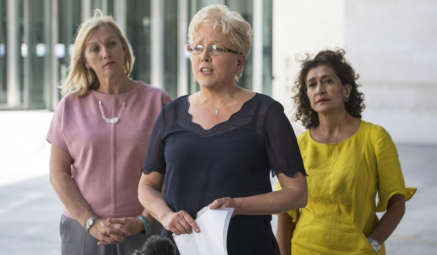 Former BBC China Editor Carrie Gracie, centre, speaks to the media alongside BBC journalists Martine Croxall, left and Razia Iqbal, outside BBC New Broadcasting House, after Gracie resolved her equal-pay dispute with the BBC, in London, Friday June 29, 2018. The BBC has struck a deal with a senior BBC journalist who quit her post to protest the media company's gender pay gap. The broadcaster accepted Friday that Carrie Gracie, the broadcaster's former China editor, had been told she would be paid along the same lines as the North American editor when she took her post. (Dominic Lipinski/PA via AP)