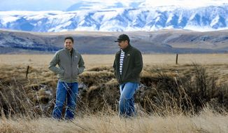 FILE - In this file photo taken on Feb. 17, 2015, Clayvin Herrera, right, a game warden for the Crow Tribe, and fellow tribe member Ronnie Fisher, are shown on the Crow Reservation in northern Wyoming. The U.S. Supreme Court will review a case in which Herrera, a Crow tribal member and former game warden from Montana is asserting his treaty right to hunt elk in the Bighorn National Forest in Wyoming. The Billings Gazette reports the high court agreed Thursday, June 28, 2018, to review Herrera's case, who was found guilty of killing an elk Wyoming in January 2014. (James Woodcock/The Billings Gazette via AP,File)