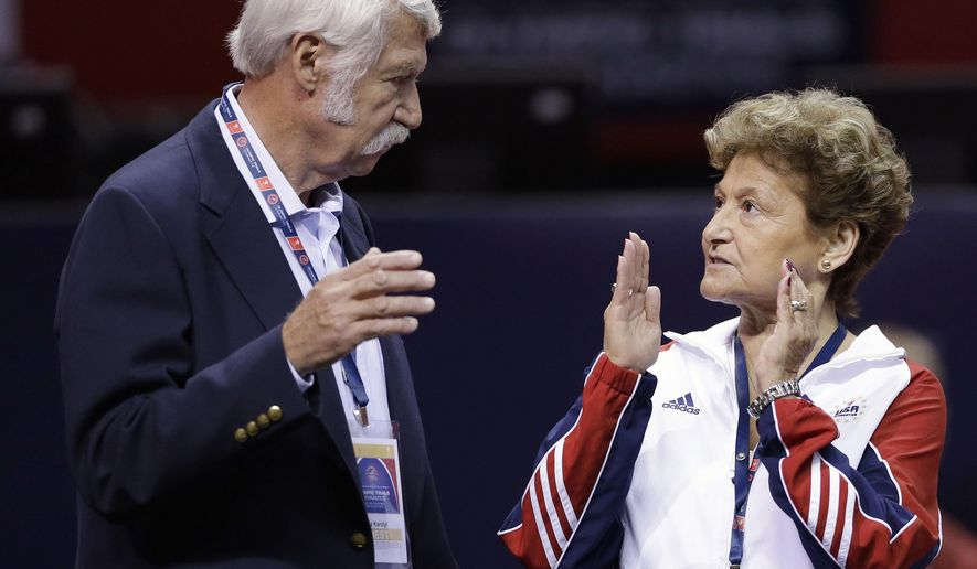 FILE - In this June 29, 2012, file photo, Bela Karolyi, left, and his wife, Martha Karolyi, talk on the arena floor before the start of the preliminary round of the women's Olympic gymnastics trials in San Jose, Calif. Investigators in Texas on Friday, June 29, 2018, are expected to address allegations of criminal behavior by disgraced former sports doctor Larry Nassar at the famed gymnastics training center in Texas that was run by the Karolyis. The facility has since closed and Nassar has been imprisoned for life. (AP Photo/Gregory Bull, File)