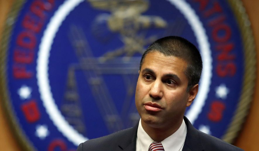 """FILE - In this Dec. 14, 2017, file photo, Federal Communications Commission Chairman Ajit Pai arrives for an FCC meeting in Washington. Prosecutors say a Southern California man is accused of threatening to kill the family of Pai. Markara Man, of Norwalk, Calif., was arrested Friday, June 29, 2018, after he admitted that he made the threats because he was """"angry"""" over the federal agency's attempt to repeal net neutrality rules and wanted to """"scare"""" the chairman. (AP Photo/Jacquelyn Martin, File)"""