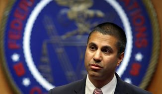 "FILE - In this Dec. 14, 2017, file photo, Federal Communications Commission Chairman Ajit Pai arrives for an FCC meeting in Washington. Prosecutors say a Southern California man is accused of threatening to kill the family of Pai. Markara Man, of Norwalk, Calif., was arrested Friday, June 29, 2018, after he admitted that he made the threats because he was ""angry"" over the federal agency's attempt to repeal net neutrality rules and wanted to ""scare"" the chairman. (AP Photo/Jacquelyn Martin, File)"