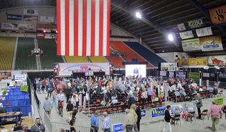 GOP delegates gather in a general session during the Idaho Republican convention in Pocatello, Idaho, on Friday, June 29, 2018. Delegates are debating changes to the party platform and resolutions that include opposing a ballot initiative seeking to expand Medicaid. (AP Photo/Kimberlee Kruesi)