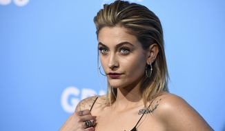 """In this March 6, 2018, file photo, Paris Jackson arrives at the Los Angeles premiere of """"Gringo"""" at Regal L.A. Live. (Photo by Jordan Strauss/Invision/AP) ** FILE **"""