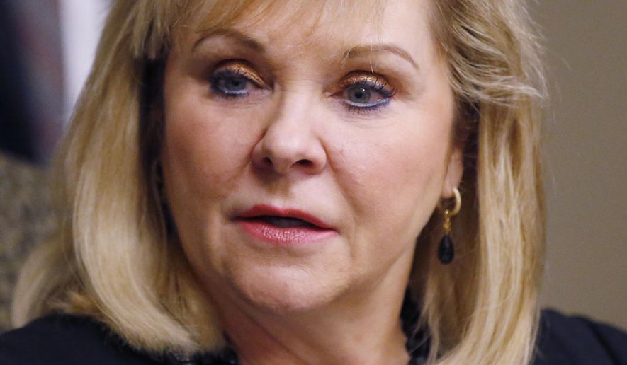 FILE - In this Tuesday, Feb. 20, 2018 file photo, Oklahoma Governor Mary Fallin speaks with the media in Oklahoma City. Fallin says she won't call the Legislature into a special session on medical marijuana, Friday, June 29, 2018. (AP Photo/Sue Ogrocki)