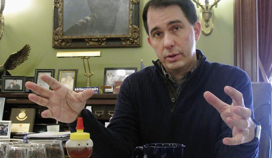 FILE - In this Jan. 8, 2018, file photo, Wisconsin Gov. Scott Walker speaks in Madison, Wis. A U.S. Supreme Court ruling making it easier to collect online sales taxes could yield billions of dollars for state and local governments _ if they decide to keep it. Rather than spend the windfall on schools, prisons or other government services, some Republican governors and lawmakers are proposing to give it away in the form of additional tax cuts to residents. Walker, running for a re-election this year, has suggested the extra revenue from online sales taxes could be used to expand tax breaks for senior citizens or families with children. (AP Photo/Scott Bauer, File)