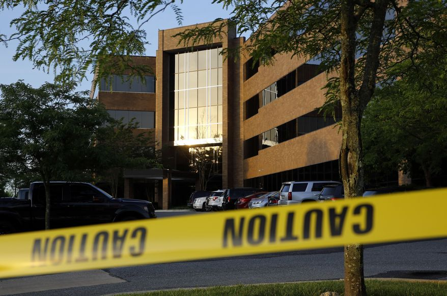 Crime scene tape surrounds a building housing The Capital Gazette newspaper's offices, Friday, June 29, 2018, in Annapolis, Md. A man armed with smoke grenades and a shotgun attacked journalists in the building Thursday, killing several people before police quickly stormed the building and arrested him, police and witnesses said. (AP Photo/Patrick Semansky) ** FILE **