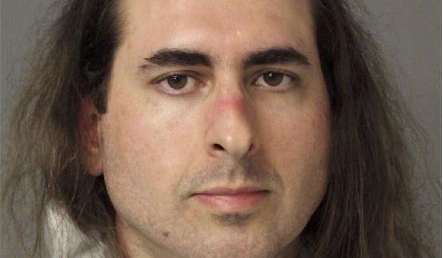 In this June 28 2018, file photo released by the Anne Arundel Police, Jarrod Warren Ramos poses for a photo, in Annapolis, Md. First-degree murder charges were filed Friday against Ramos who police said targeted Maryland's capital newspaper, shooting his way into the newsroom and killing four journalists and a staffer before officers swiftly arrested him. (Anne Arundel Police via AP)