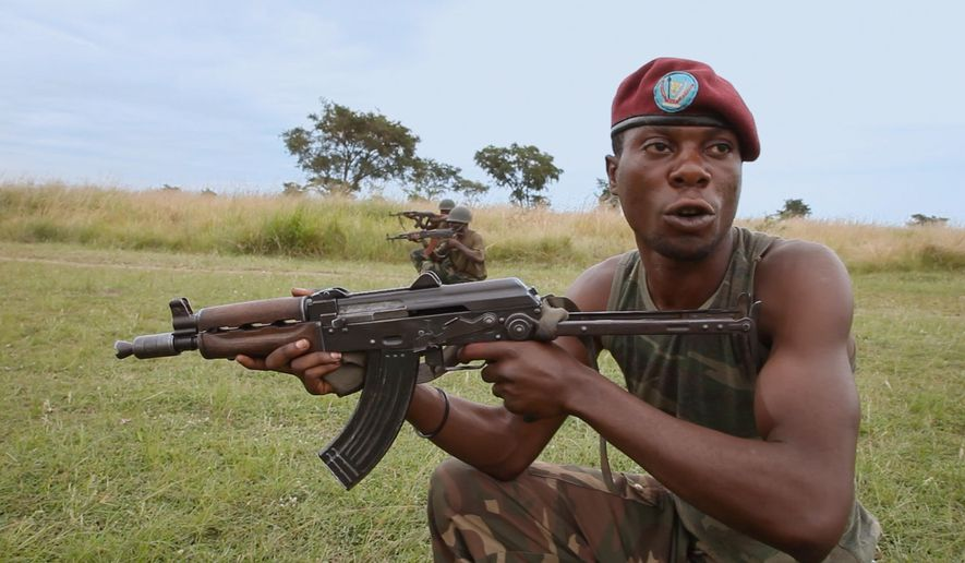 "This photo provided by Abramorama shows a scene from the film  ""This Is Congo.""  The movie is directed and filmed by former photojournalist Daniel McCabe.   Traveling around the Kivu regions in the east, McCabe sought to explore the root causes of conflict in Congo.  (Daniel McCabe/Abramorama via AP)"