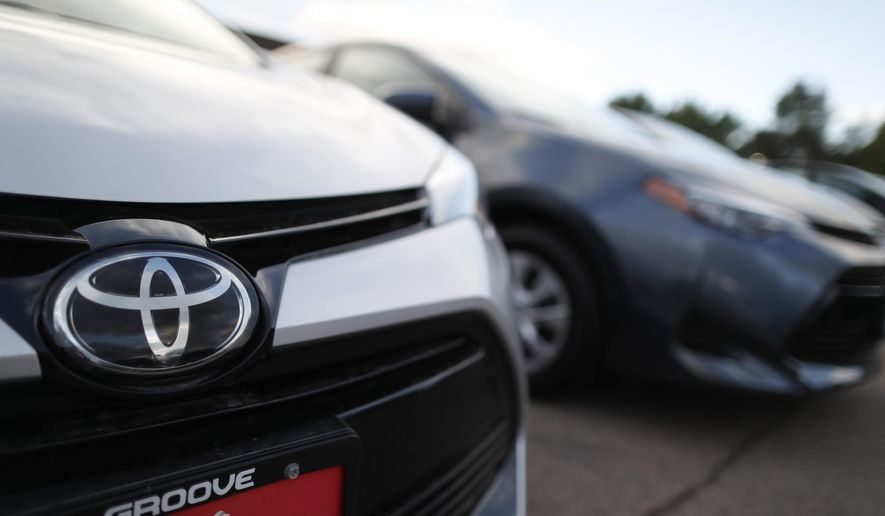 """FILE - This Sunday, June 24, 2018 file photo shows the Toyota company logo on a car at a Toyota dealership in Englewood, Colo. Foreign automakers, American manufacturers and classic-car enthusiasts are coming out against President Donald Trump's plan to consider taxing imported cars, trucks and auto parts. Toyota Motor North America says the tariffs """"would have a negative impact on all manufacturers, increasing the cost of imported vehicles as well as domestically produced vehicles that rely on imported parts."""" Friday, June 29, 2018 is the deadline for public comments on Trump's call for a Commerce investigation into whether auto imports pose enough of a threat to U.S. national security to justify tariffs. (AP Photo/David Zalubowski, File)"""