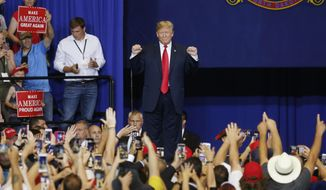 President Donald Trump arrives to speak at a campaign rally Wednesday, June 27, 2018, in Fargo, N.D. Trump was in Fargo to campaign for Republican Senate hopeful Kevin Cramer, who is hoping to unseat Democrat Heidi Heitkamp. (AP Photo/Jim Mone)