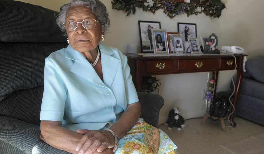 """FILE - In this Oct. 7, 2010 file photo, Recy Taylor appears at her home in Winter Haven, Fla. In 1944, Taylor, then 24, married and a mother, was raped by six white youths while she walked to her Abbeville, Alabama, home after an evening church service. Her story and its connection to female civil rights activists are illuminated in filmmaker Nancy Buirski's documentary """"The Rape of Recy Taylor,"""" airing 9 p.m. EDT Monday on the Starz channel. (AP Photo/Phelan M. Ebenhack, File)"""
