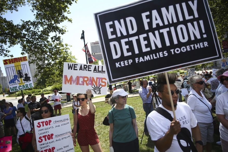 People gather to protest against President Donald Trump's immigration policies at Logan Square in Philadelphia, Saturday, June 30, 2018. Hundreds of thousands of protesters have packed rallies across the United States to demand an end to family separations at the U.S.-Mexico border.  (Tim Tai/The Philadelphia Inquirer via AP) **FILE**