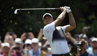Tiger Woods watches his tee shot on the third hole during the third round of the Quicken Loans National golf tournament, Saturday, June 30, 2018, in Potomac, Md. (AP Photo/Nick Wass)