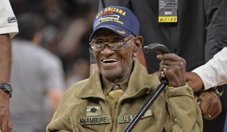 "Richard Overton leaves the court after a special presentation honoring him as the oldest living American war veteran, during a timeout in an NBA basketball game between the Memphis Grizzlies and the San Antonio Spurs,"" March 23, 2017. (Associated Press) ** FILE **"