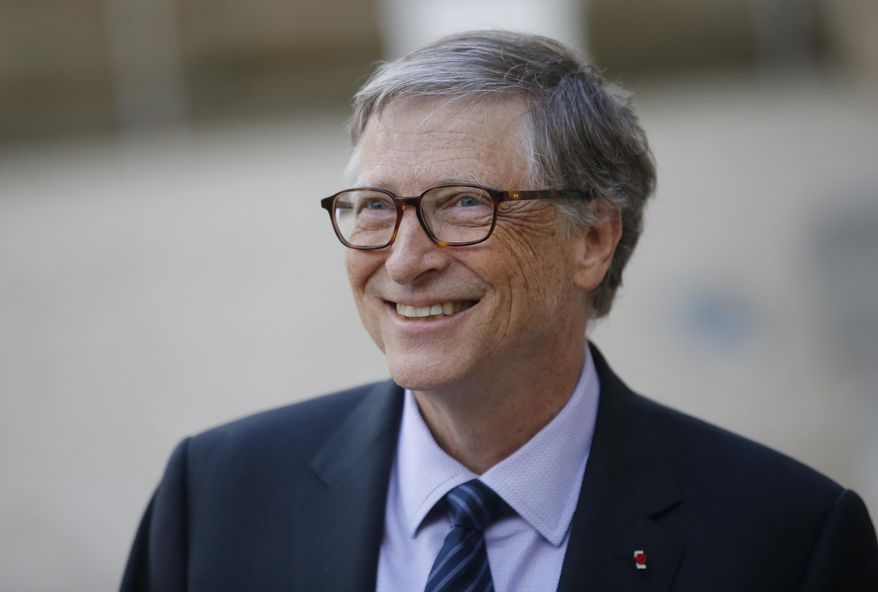 FILE - In this April 16, 2018, file photo, Bill Gates, Co-Chair of the Bill & Melinda Gates Foundation, talks to the media after a meeting with French President Emmanuel Macron at the Elysee Palace in Paris. The Seattle region is home to the two richest men in America, but while Amazon's Jeff Bezos is blamed by some for rising rents and clogged city streets, Gates is largely admired for helping lead the computing revolution and for the billions he donates through his philanthropy. (AP Photo/Michel Euler, File)