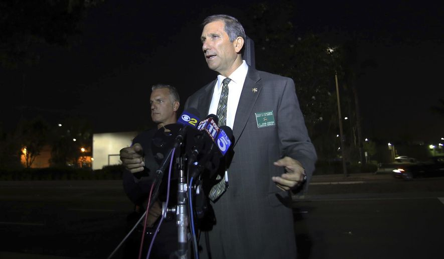 Los Angeles County sheriff's Lt. John Corina addresses the media after Pomona and campus police shot and killed a suspect connected to the stabbing death of a Cal Poly Pomona public security specialist, at the John T. Lyle Center at Cal Poly Pomona in Pomona, Calif., Friday, June 29, 2018. The names of the two men who died haven't been released but Corina says witnesses told authorities the suspect was a campus custodian. (James Carbone/The Press-Enterprise via AP)
