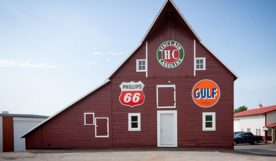 Robert and Sharon Bruning's red barn on their farm Thursday, June 14, 2018, in Omaha, Neb. They now face a legal challenge that threatens to end the operation as it exists today. (Kent Sievers/Omaha World-Herald via AP)