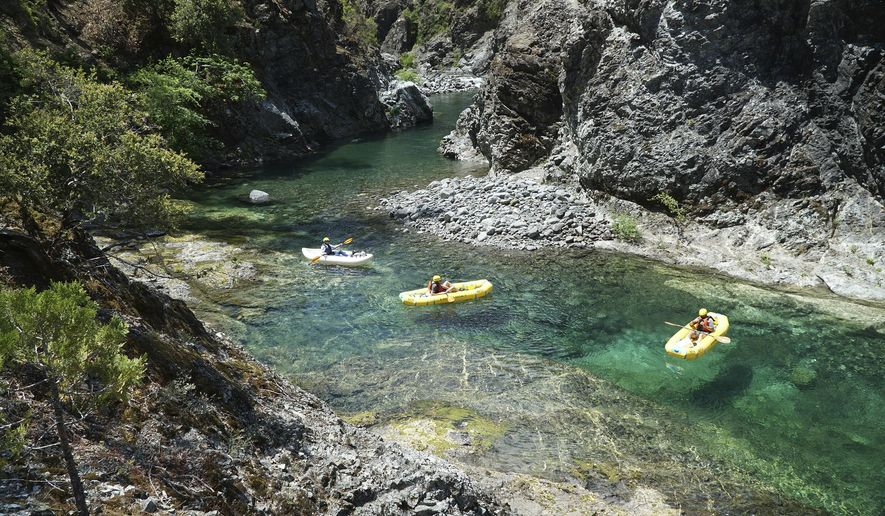 In a June 2018 photo, kayakers paddle through the Magic Canyon of the Chetco River. The National Wild and Scenic Rivers Act turns 50 this year. (Zach Collier/The Medford Mail Tribune via AP)