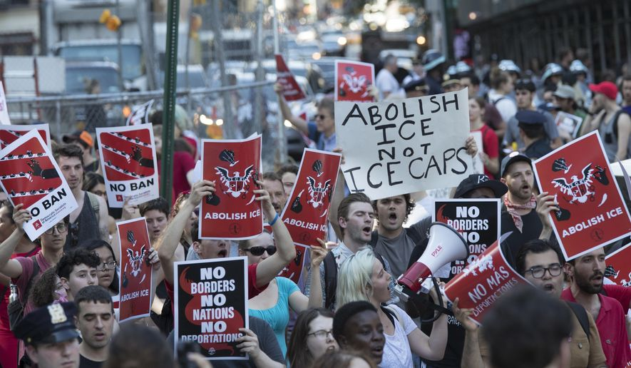 Protesters chant slogans as they march during a demonstration calling for the abolishment of Immigration and Customs Enforcement, or ICE, and demand changes in U.S. immigration policies, Friday, June 29, 2018, in New York. (AP Photo/Mary Altaffer)