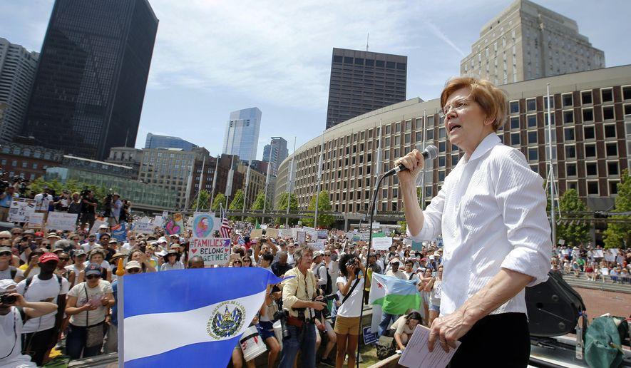 Sen. Elizabeth Warren, D-Mass., speaks during a Rally Against Separation Saturday, June 30, 2018, in Boston. (AP Photo/Winslow Townson)