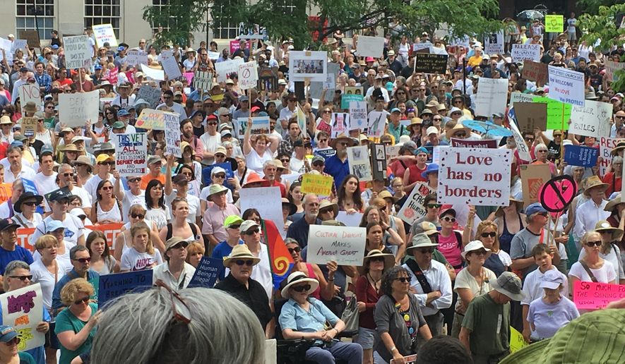 About 2,000 people protest Trump administration immigration policies outside City Hall in Portland, Maine, on Saturday, June 30, 2018. (AP Photo/David Sharp)
