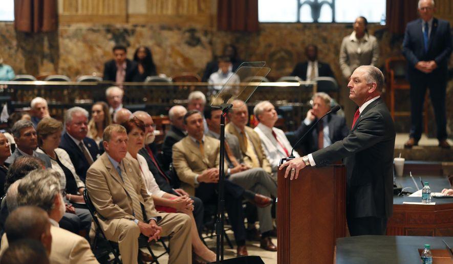 Louisiana Gov. John Bel Edwards, right, speaks at the opening of a special legislative session in Baton Rouge, La., Monday, June 18, 2018. (AP Photo/Gerald Herbert)