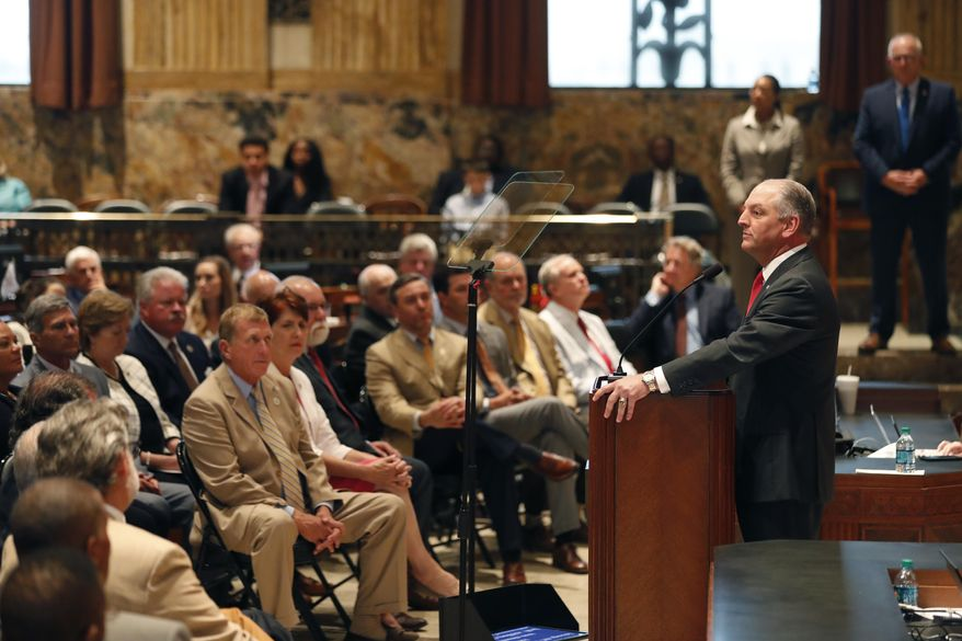 Louisiana Gov. John Bel Edwards, right, speaks at the opening of a special legislative session in Baton Rouge, La., Monday, June 18, 2018. (AP Photo/Gerald Herbert)