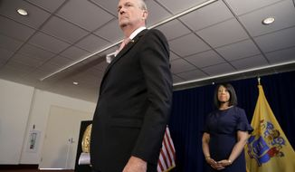 New Jersey Gov. Phil Murphy, left, steps forward to listen to a reporter's question news conference with Lt. Gov. Sheila Oliver, right, after he and Democratic legislative leaders failed to strike a budget deal, Friday, June 29, 2018, in Trenton, N.J. The governor and senate democratic leaders have not agreed on a a deal and if a balanced budget is not in place by midnight Saturday the state government faces a shutdown. The major sticking point has been how much to raise taxes. The first-term Democratic governor wants to raise the income tax rate on people making more than $1 million to 10.75 percent. (AP Photo/Julio Cortez)