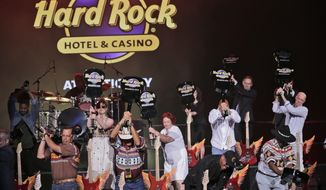 FILE - In this June 28, 2018 file photo, celebrities and VIPs smash guitars as part of the grand opening celebration at the Hard Rock Hotel and Casino in Atlantic City, N.J.  Even after spending a half-billion dollars on an Atlantic City casino, Hard Rock still hopes to build one in northern New Jersey near New York City one day. CEO Jim Allen says the company owns part of the Meadowlands Racetrack in East Rutherford, and has the exclusive right to operate a casino there. A proposal to allow that was resoundingly defeated by voters in 2016. (AP Photo/Seth Wenig, File )